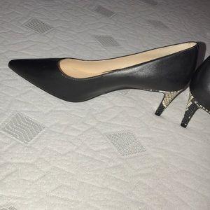 Nine West black pump with snake skin heel